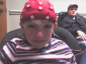 Ethan wearing the space-age QEEG cap in Dr. Walker's office