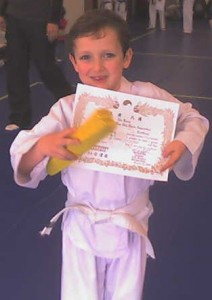 Ethan with his Yellow Belt and Belt Test Certificate