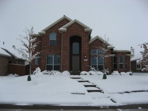 View of our house and snowcowboy from the street, Friday 2-12-09